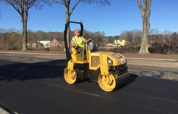 Ace Paving specialist operating asphalt finisher