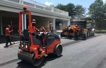 Ace Paving staff while asphalt drive resurfacing